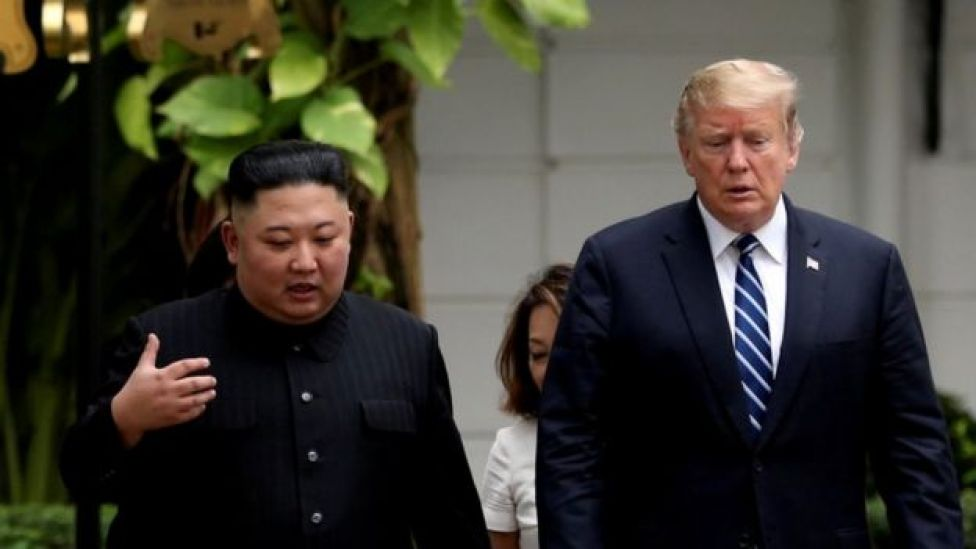 North Korea president Kim Jong-un and US president Donald Trump walking through the garden of the Metropole hotel during their summit on February 28