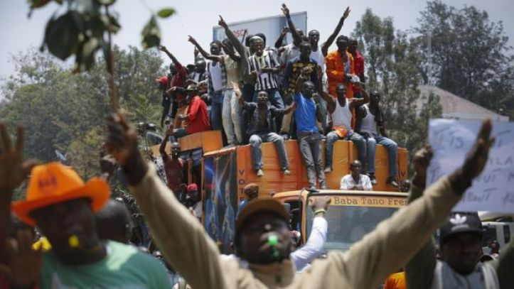 Supporters of the opposition coalition The National Super Alliance (NASA) and its presidential candidate Raila Odinga sit on top of a truck during their protest against the country