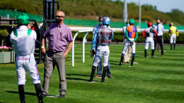 Social distancing in the parade ring at Newcastle Racecourse, as racing resumes behind closed doors following the outbreak of the coronavirus disease (COVID-19), Newcastle Upon Tyne,