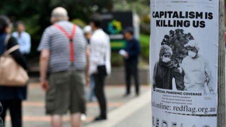 Cartaz dizendo que o capitalismo está nos matando