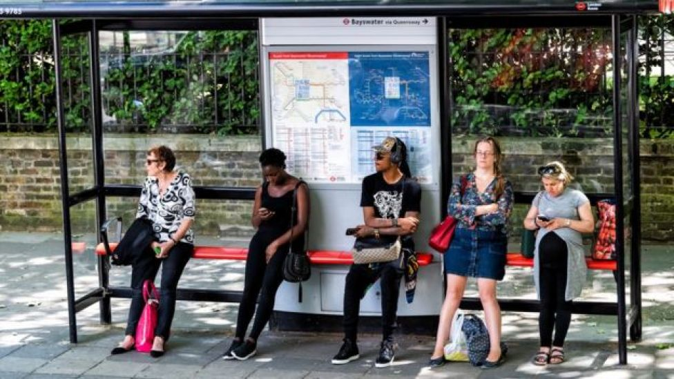 Group of people at a bus stop