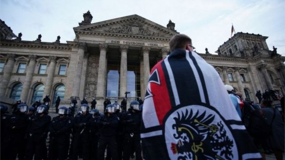 A right-wing protester in front of Germany's Reichstag, 29 August 2020