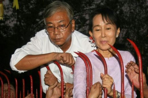 In this file picture taken on 13 November 2010, Htin Kyaw (L), a senior National League for Democracy (NLD) official stands next to Aung San Suu Kyi (R) at her residence on the day of her release from house arrest in Yangon where she was detained for nearly two decades