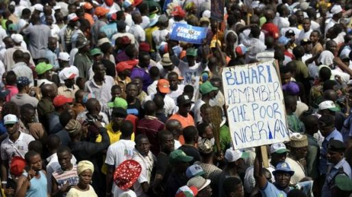 A supporter of Nigeria's leading opposition All Progressive Congress (APC) holds a banner during a campaign rally at the Taslim Balogun Stadium in Lagos on January 30, 2015.