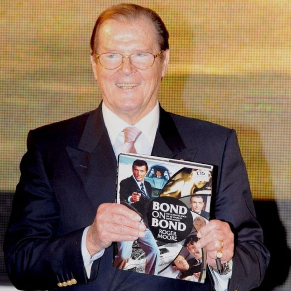 Roger Moore at a book signing in 2012