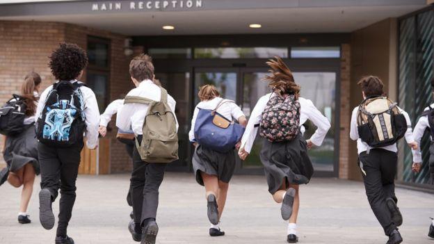 Schoolchildren running into school