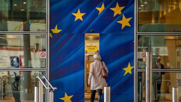 A woman walking into the European Commission building in Brussels