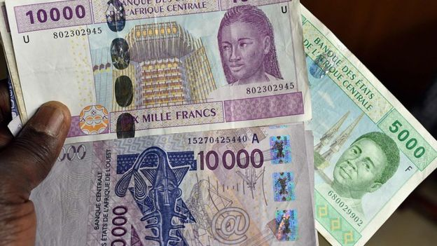 This photo taken on April 9, 2016 in a N'Djamena, Chad, shows CFA banknotes of the CFA currency issued by the Central Bank of West African States (Banque Centrale des Etats de l'Afrique de l'Ouest, BCEAO) and used in the eight west African countries which share the common West African CFA franc currency.