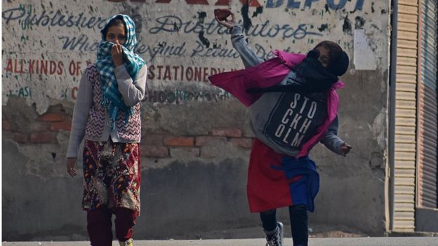 A female protester throws stones during clashes in Srinagar, Kashmir, on October 29, 2019