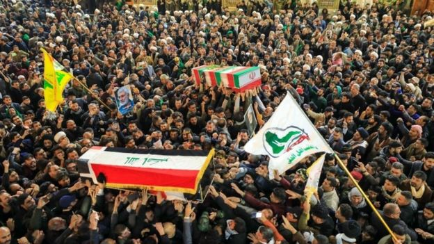 People mourn next to the coffins of slain Abu Mahdi al-Muhandis and Qassem Soleimani during a funeral procession in Najaf, Iraq, 04 January 2020