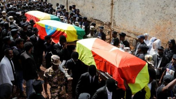 Mourners carry the coffin of Amhara president Ambachew Mekonnen and two other officials who where killed in an attack, during their funeral in the town of Bahir Dar, Amhara region