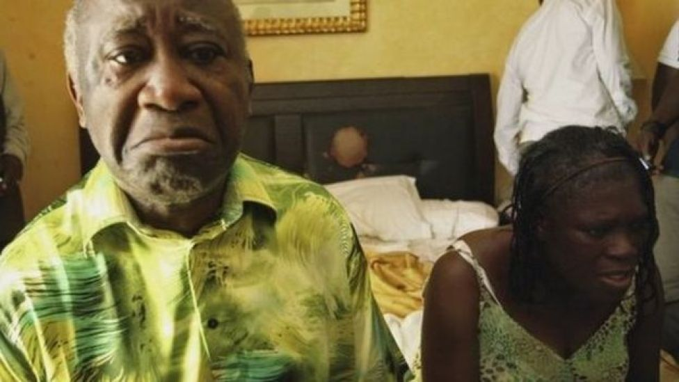 Ivory Coast's Laurent Gbagbo (L) and his wife Simone sit in a room at Hotel Golf in Abidjan, after they were arrested on 11 April 2011