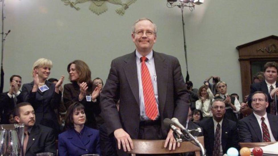 Independent Counsel Ken Starr stands after testifying during Bill Clinton impeachment hearings.