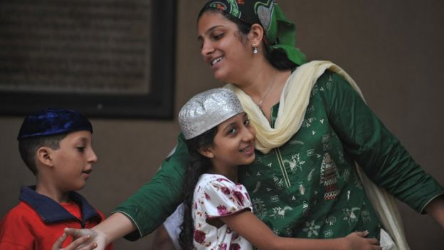Parsis greet each other after offering prayers during the Parsi New Year 'Navroze' in Mumbai on August 19, 2010. Parsis, followers of Zoroastrianism, a small religious community which exists largely in Mumbai, were exiled from Iran in the 7th century AD during religious persecution by the Muslims.