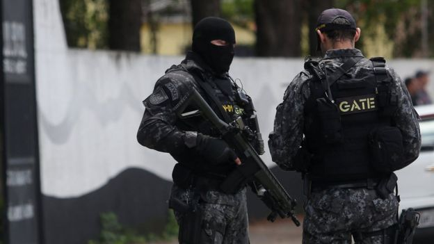 Policemen are seen at the Raul Brasil school after a shooting in Suzano