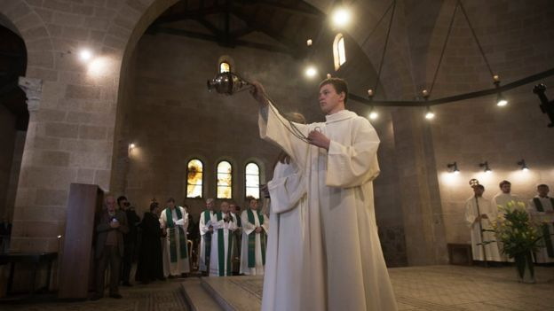 Christian clerics during a Holy Mass at the Church of Loaves and Fishes, in Tabgha