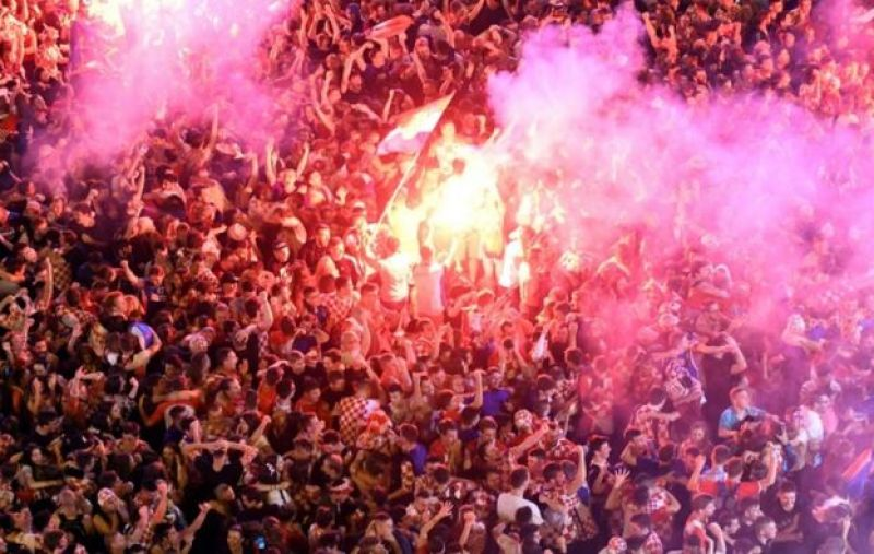 Croatia supporters celebrate the second goal as they watch on a giant screen the Russia 2018 World Cup semi-final football match between Croatia and England, at the main square in Zagreb