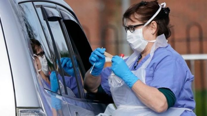 A member of the public is swabbed at a drive through coronavirus testing site in Wolverhampton