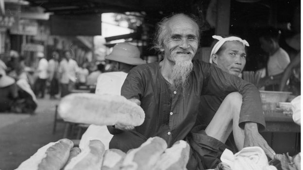 A bread seller in Saigon, circa 1956