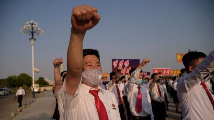 """North Korean students take part in a rally denouncing """"defectors from the North"""" as they march from the Pyongyang Youth Park Open-Air Theatre to Kim Il Sung Square in Pyongyang on June 8, 2020."""
