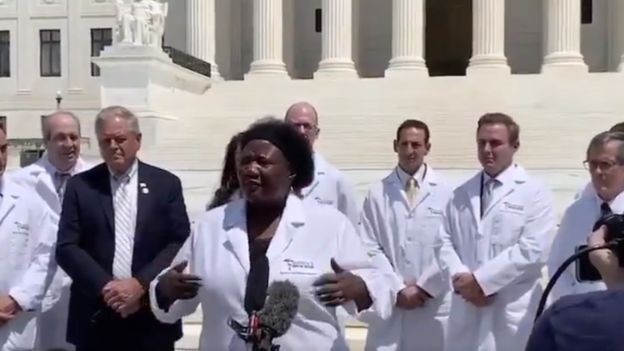 A video clip showing doctors gathering in front of the American Supreme Court