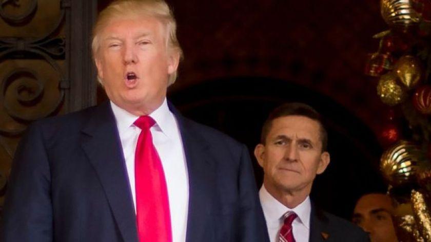 Michael Flynn watches Donald Trump speak.
