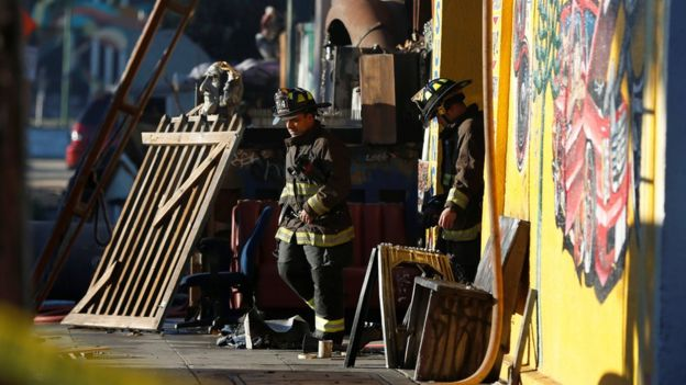 Firefighters exit a warehouse where a fire broke out during an electronic dance party late Friday evening, resulting in at least nine deaths and many unaccounted for in the Fruitvale district of Oakland, California, U.S. December 3, 2016.