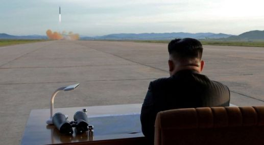 Kim Jong-un watching missile launch