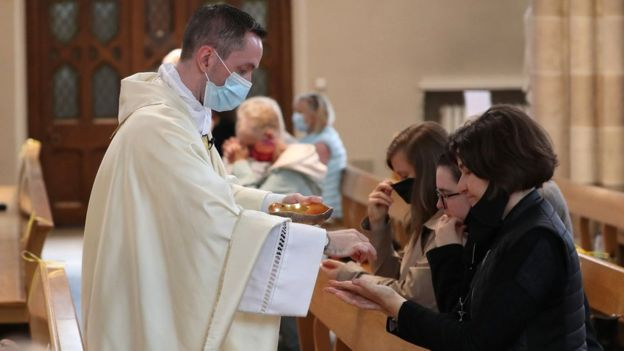 Canon Gerald Sharkey during Communion at the first mass held at St Andrew's Cathedral in Glasgow since 19 March