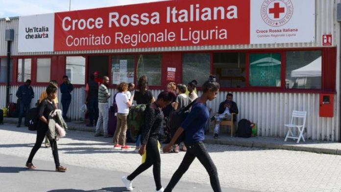 Migrants walk at the Italian Red Cross camp in Ventimiglia, northern Italy, on June 15, 2018