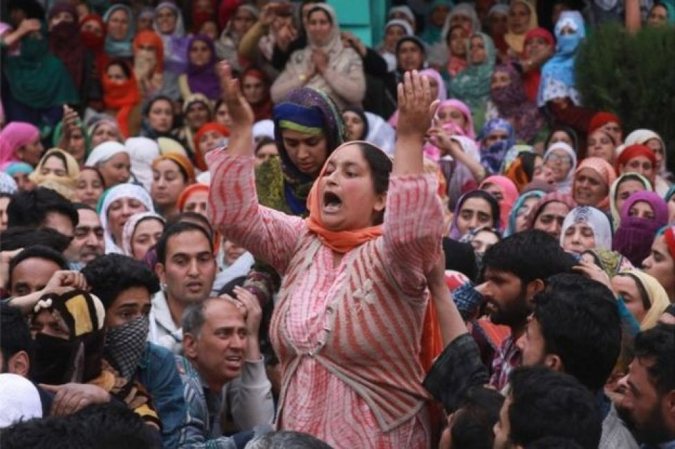 Kashmiri Muslim women mourn during the funeral procession of an Assistant Professor turned militant Dr. Muhammad Rafi Bhat during his funeral procession in Ganderbal, some 35 kilometers northwest of Srinagar, the summer capital of Indian Kashmir, 06 May 2018