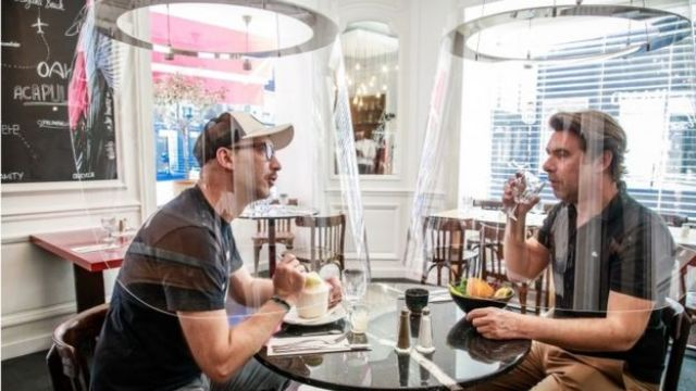 French designer Christophe Gernigon (R) in a possible invention to allow restaurant dining