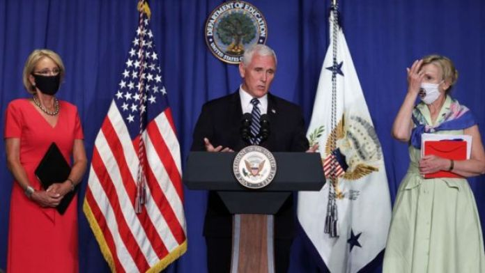 Mr Pence speaks alongside health and education officials