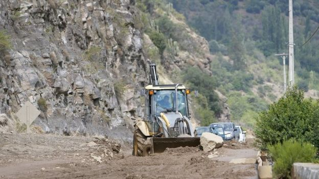 A tractor clears the road heading toward San Jose de Maipo Volcano after heavy rains caused landslides in the San Jose de Maipo region, near Santiago, Chile, 26 February 2017.