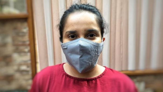 Activist and aid worker Srabonti Huda wearing a face mask
