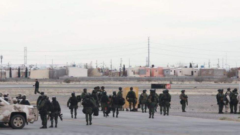 Mexican soldiers on guard at Ciudad Juarez airport, where El Chapo Guzman's plane took off