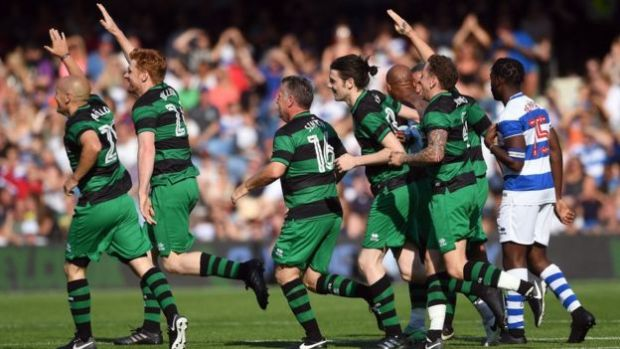 Players from team Shearer celebrate Trevor Sinclair's goal