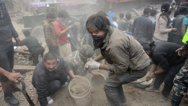 People clear rubble in Kathmandu, Nepal, after the earthquake on 25 April, 2015