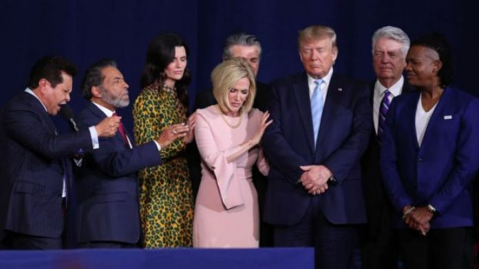 Donald Trump praying with evangelical leaders in January 2020