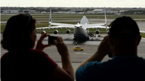 People take photos of the An-225 at Perth airport