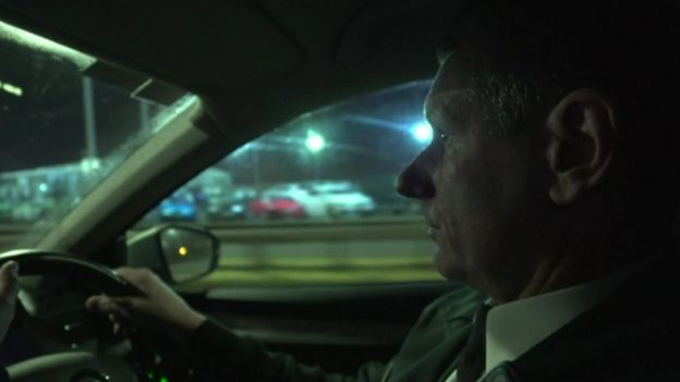 Insp Cavanagh driving a police car