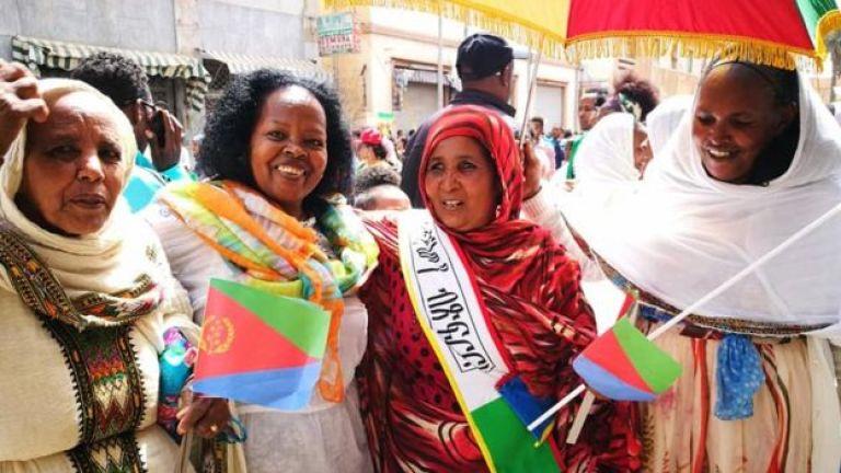 Women with flags in Asmara