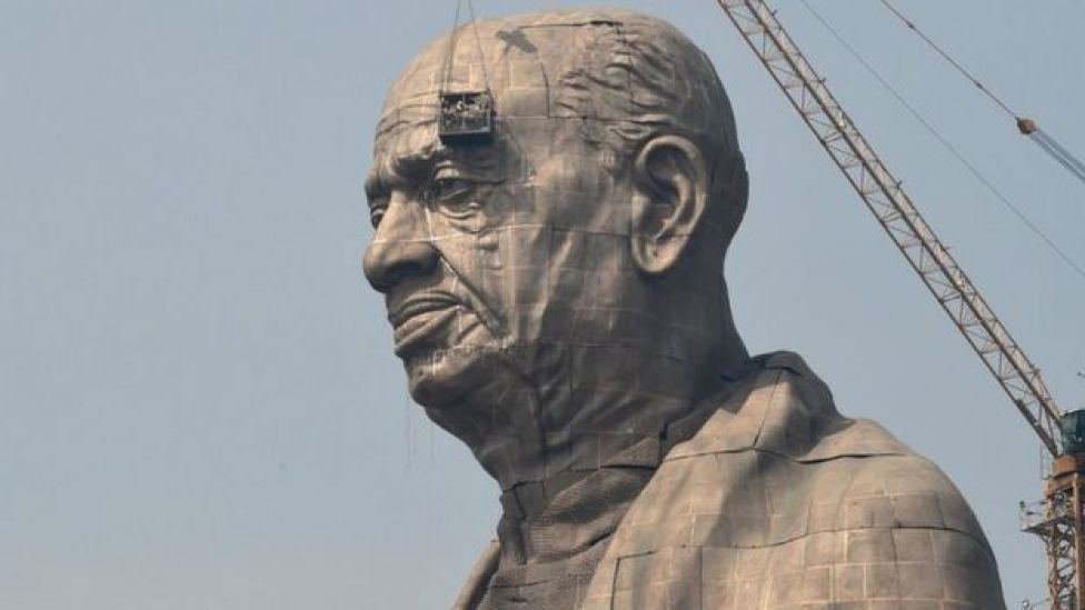 Indian workers give the finishing touches to the world's tallest statue dedicated to Indian independence leader Sardar Vallabhbhai Patel in India's western Gujarat state.