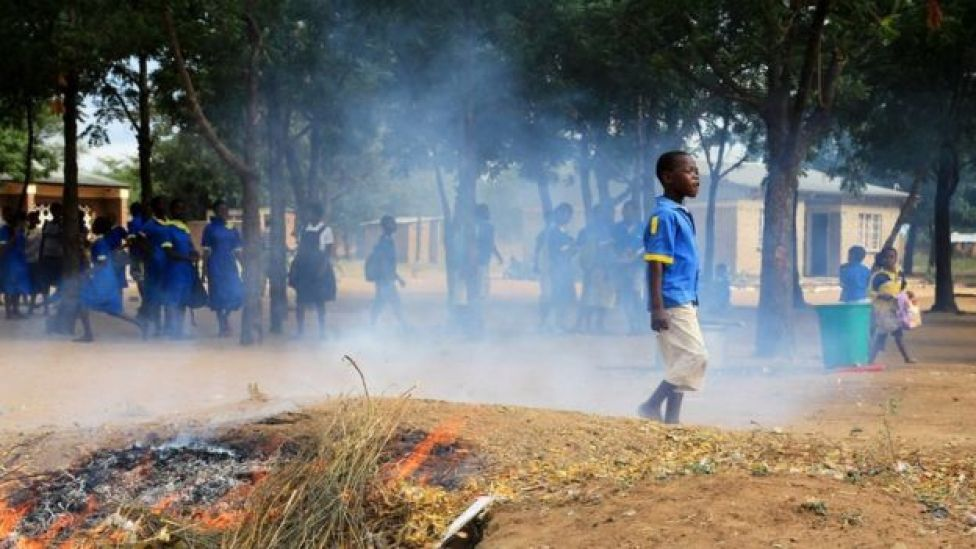 School children in Malawi playing in smoky air