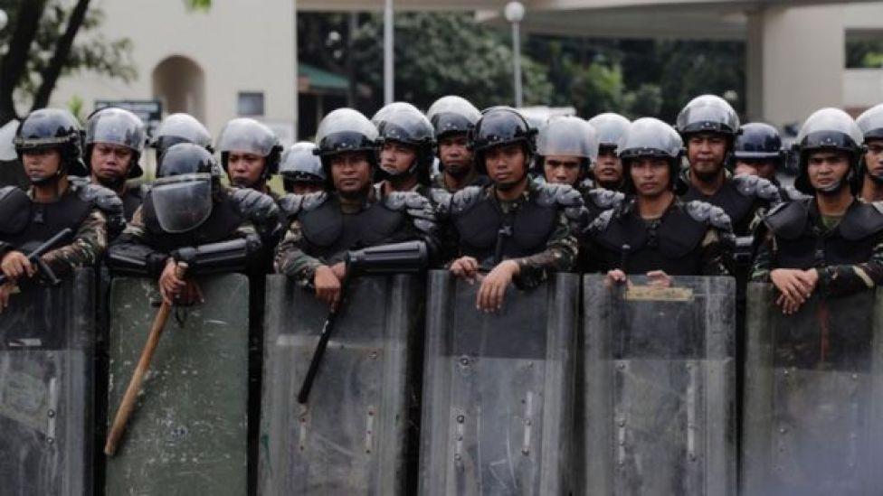 Policía en una manifestación