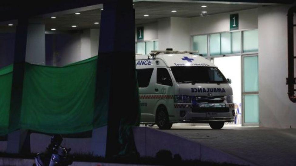 An ambulance parks at the entrance of Chiang Rai Prachanukroh hospital