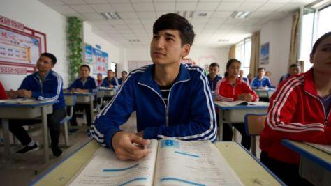 A Uighur man studying at a camp