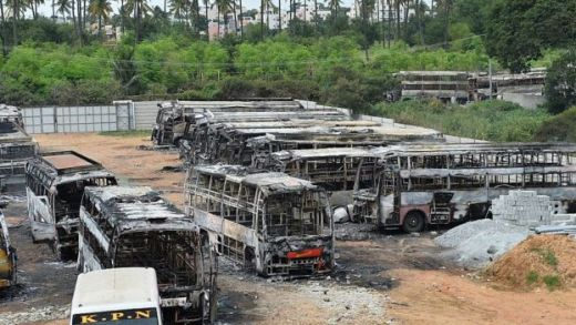 The skeletal remains of several buses belonging to a private travel company are parked in the yard after being set on fire by an angry mob during violence due to the Cauvery water dispute