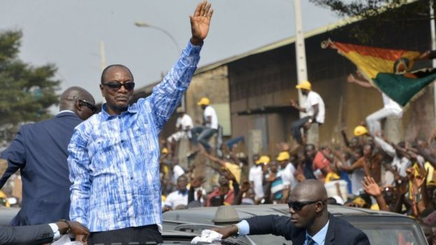 Alpha Conde greets his supporters in Conakry (archive shot)
