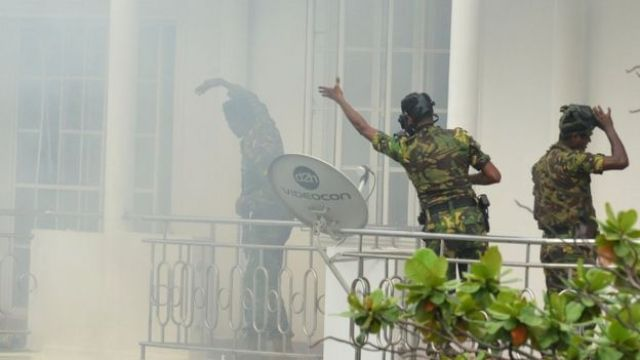 A bomb goes off as Special Task Force personnel raid a home near Dematagoda in Colombo
